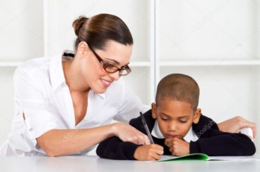 depositphotos_10983371-stock-photo-caring-elementary-teacher-helping-schoolboy